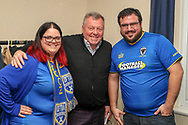 AFC Wimbledon fans with AFC Wimbledon manager Wally Downes during the EFL Sky Bet League 1 match between AFC Wimbledon and Accrington Stanley at the Cherry Red Records Stadium, Kingston, England on 6 April 2019.