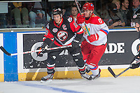 KELOWNA, CANADA - NOVEMBER 9: Alexander Protapovich #17 of Team Russia checks Brayden Point #19 of Team WHL on November 9, 2015 during game 1 of the Canada Russia Super Series at Prospera Place in Kelowna, British Columbia, Canada.  (Photo by Marissa Baecker/Western Hockey League)  *** Local Caption *** Alexander Protapovich; Brayden Point;
