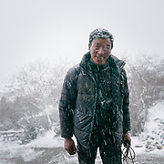 Kandu Wangchuk returns from his daily 2 days commute to get supplies in the lower valley. Life at Mr and Ms Wangchuk's house on the edge of the Laya village.