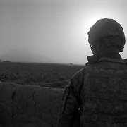 US soldiers patrolling down a path in a small rural farming village in Maiwand District, Kandahar, Afghanistan following up on Afghan civilian reports on insurgent activity. (Credit Image: © Louie Palu/ZUMA Press/The Alexia Foundation).....