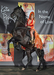 "© licensed to London News Pictures. London, UK 21/06/2012. Katie Price posing on a horse as she launches her new novel ""In The Name of Love"" in the Worx Studios, south-west London, today. Photo credit: Tolga Akmen/LNP"