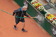 Gardner assistant of Suzanne Lenglen stadium cleaned up the advertisings by water jet the during the Roland Garros 2020, Grand Slam tennis tournament, on October 5, 2020 at Roland Garros stadium in Paris, France - Photo Stephane Allaman / ProSportsImages / DPPI