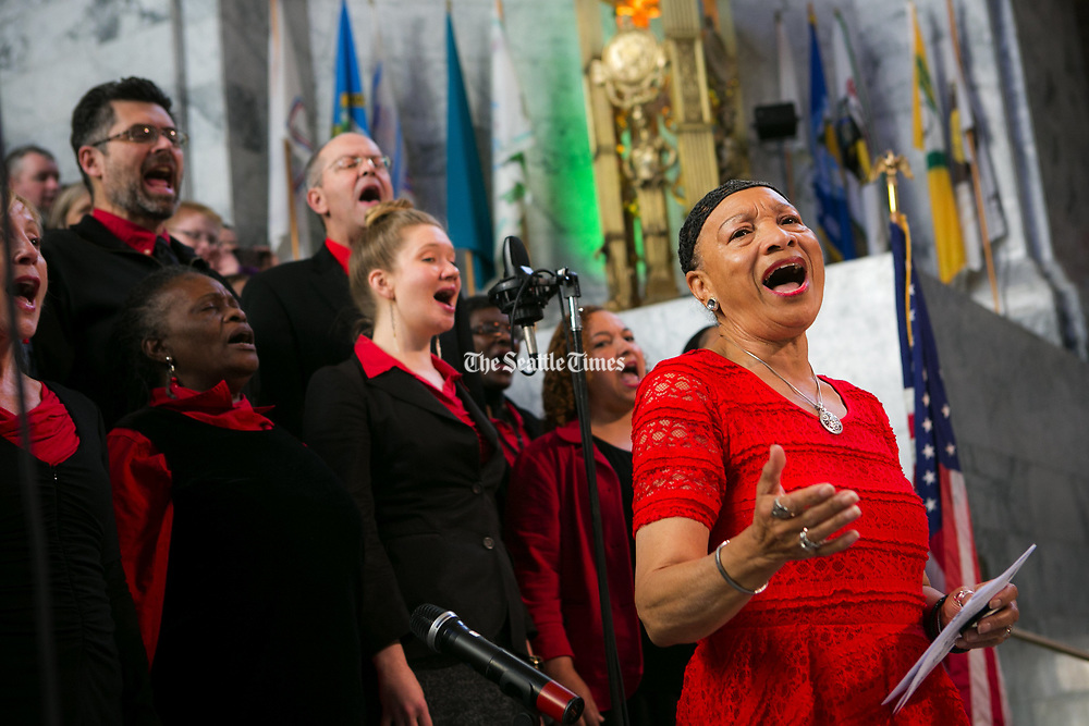 Pastor Patrinell Wright leads the Total Experience Gospel Choir to sing the Star Spangled Banner for the Washington 125 celebration in the rotunda. (Bettina Hansen / The Seattle Times)