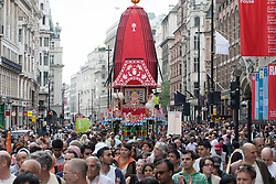 © licensed to London News Pictures. London, UK 17/06/2012. Three chariots being pulled in Piccadilly as people celebrating Hare Krishna, an old Hindu tradition in central London, today (17/06/12). Photo credit: Tolga Akmen/LNP