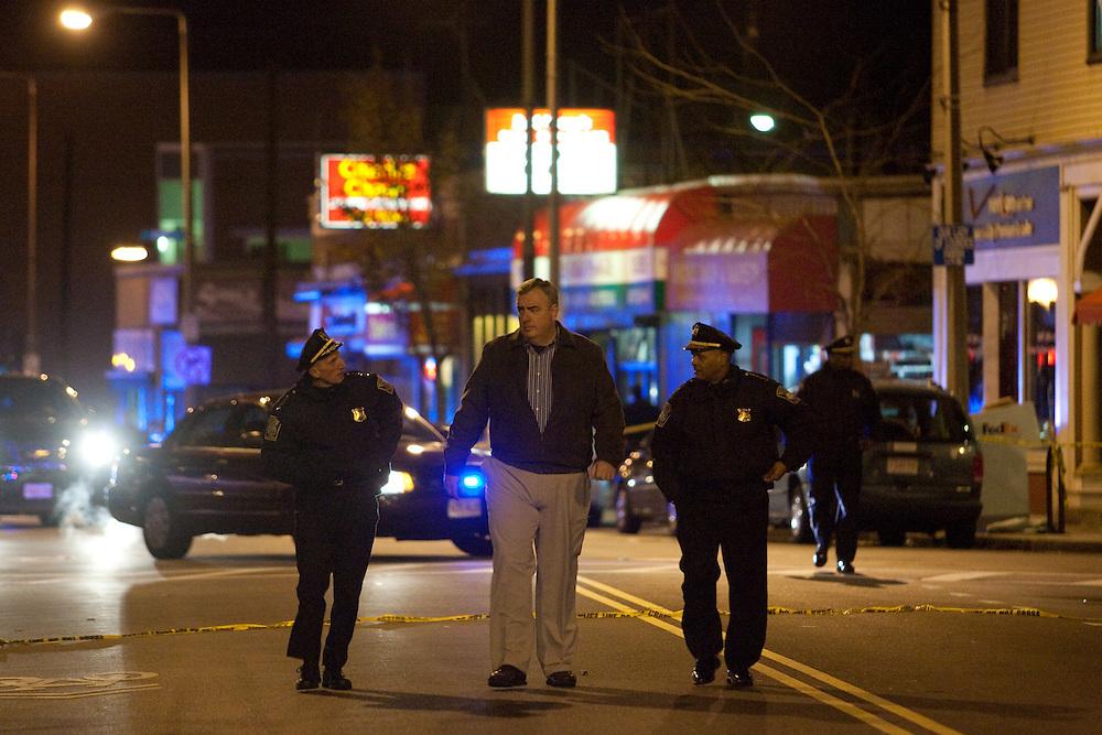 Boston, MA 11/21/2010.Boston Police Commissioner Edward Davis, center, walks down Centre St. after a shooting inside the Same Old Place restaurant in Jamaica Plain on Sunday evening..Alex Jones / www.alexjonesphoto.com