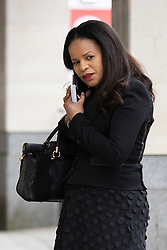 © Licensed to London News Pictures. 16/03/2021. London, UK. MP Claudia Webbe(Centre) speaks on the phone outside Westminster Magistrates Court .She is charged with one count of harassment and the trial is expected to last for one day.  Photo credit: George Cracknell Wright/LNP