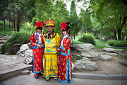 Man and two girls has here photo taken wearing traditional Chinese clothing. Beihai Park is an imperial garden in Beijing. First built in the 10th century, it is amongst the largest of Chinese gardens, and contains numerous historically important structures, palaces and temples. Since 1925, the place has been open to the public as a park. It is also connected at the south to the Shichahai. The Park has an area of more than 69 hectares, with a lake that covers more than half of the entire Park.