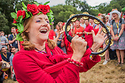 The Shakti choir (in red) honours the Earth with song and encourages people to join in, near the stone circle - The 2017 Glastonbury Festival, Worthy Farm. Glastonbury, 2 June 2017