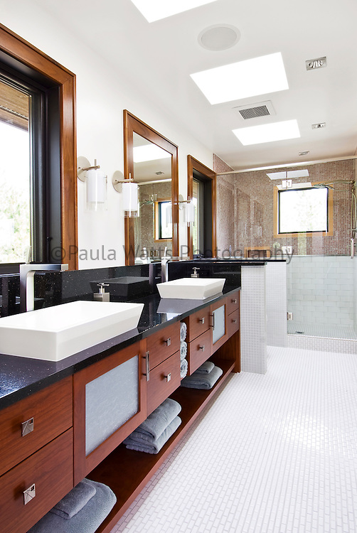 Contemporary master bathroom with custom double vanity sinks and large shower
