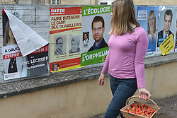 June 7, 2017 - Calvados, France - A woman passes in front of election posters with local candidates on display in front of Ducy Ste Marguerite town hall..French legislative elections are scheduled to take place on 11 and 18 June (with different dates for voters overseas) to elect the 577 members of the 15th National Assembly of the French Fifth Republic. According to the final list published by the Ministry of the Interior on 23 May, a total of 7,882 candidates are standing in the legislative elections..On Wednesday, June 7, 2017, in Ducy Ste Marguerite, Calvados, France. (Credit Image: © Artur Widak/NurPhoto via ZUMA Press)