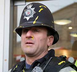 © under license to London News Pictures. 30/11/2010 Mustard on the face of a police officer outside the Vodafone store in Bristol today (30/11/2010). Police where attacked with mustard and other items by students demonstrating against proposed increases to higher education fees. Credit should read: David Hedges/LNP