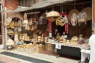 A vendor sells hand made wicker work on Shenkeng, Taiwan's Old Street.