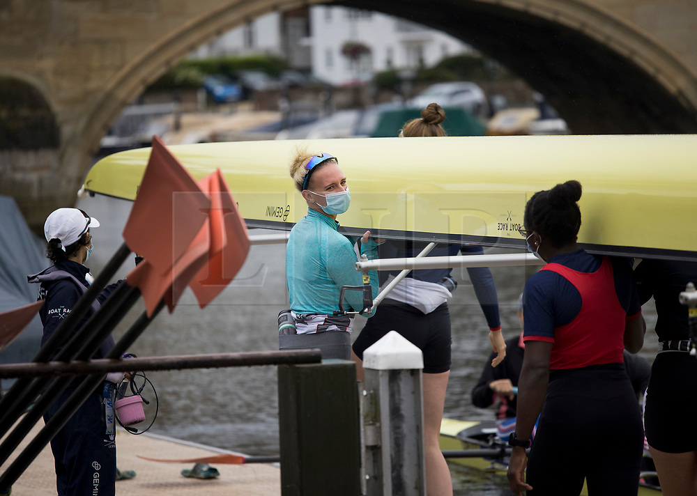© Licensed to London News Pictures. 09/08/2021. Henley-on-Thames, UK. Rowers prepare to train underneath grey skies, ahead of the the Henley Royal Regatta which starts on Wednesday. Established in 1839, the five day international rowing event, raced over a course of 2,112 meters (1 mile 550 yards), is considered an important part of the English social season. Photo credit: Ben Cawthra/LNP