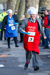 © Licensed to London News Pictures. 28/02/2017. London, UK. Channel 4's MICHAEL CRICK races against MPs and Lords at the annual Rehab Parliamentary Pancake Race outside the Parliament on Shrove Tuesday, 28 February 2017. Photo credit: Tolga Akmen/LNP