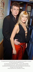 TV personality SHANE RITCHIE and  friend, at a party in London on 27th January 2003.PGR 181