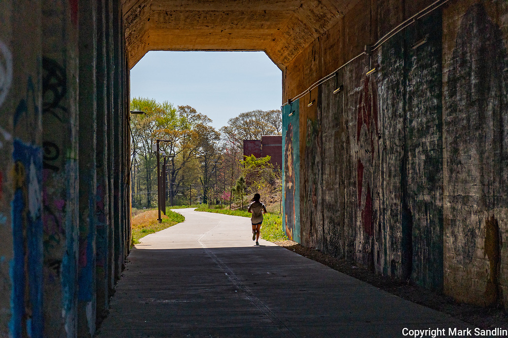 Murals and graffiti on underpass along the westside Atlanta Westside. Joggers and bikers use the trail frequently