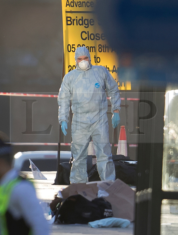 © Licensed to London News Pictures.22/03/2017.London, UK. Forensics officers are seen on Westminster Bridge after a terrorist attack on the Houses of Parliament in Westminster, London.Photo credit: Peter Macdiarmid/LNP