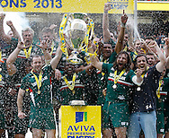 Picture by Andrew Tobin/Focus Images Ltd +44 7710 761829.25/05/2013. Martin Castrogiovanni of Leicester (R) lifts the winners trophy after beating Northampton during the Aviva Premiership match at Twickenham Stadium, Twickenham.