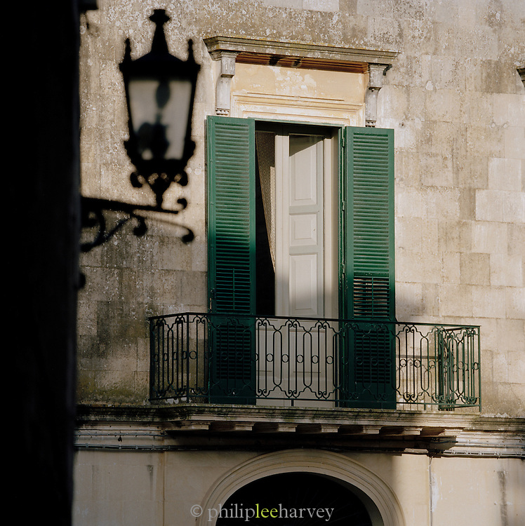 A traditional shuttered window in Puglia, Italy