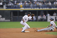 CHICAGO - SEPTEMBER 29:  Alexei Ramirez #10 of the Chicago White Sox fields a throw to second base during the game against the Detroit Tigers at U.S. Cellular Field in Chicago, Illinois on September 29, 2008.  The White Sox defeated the Tigers 8-2.  (Photo by Ron Vesely)
