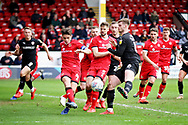 Walsall FC midfielder George Dobson (4) clears this corner before Barnsley defender Liam Lindsay (6) can get a shot in during the EFL Sky Bet League 1 match between Walsall and Barnsley at the Banks's Stadium, Walsall, England on 23 March 2019.