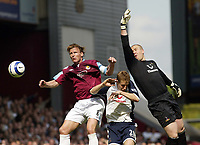 Photo: Chris Ratcliffe.<br /> West Ham United v Tottenham Hotspur. The Barclays Premiership. 07/05/2006.<br /> Teddy Sheringham of West Ham tussles with Michael Dawson (centre) and Paul Robinson in the Spurs goal.