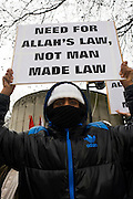 Islamic extremists protest opposite the London Libyan embassy and demand Shariah law after the Gaddafi uprising. Holding up their placards that ask for Shariah law for Libya and that Democracy is the path to Hellfire, the young British radicals stand behind barriers near Hyde Park Corner denouncing Colonel Gaddafi and for their views and ideology to become the way of life for the north African country.