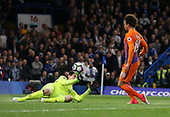 Chelsea's Thibaut Courtois saves from Manchester City's Leroy Sane during the Premier League match at the Stamford Bridge Stadium, London. Picture date: April 5th, 2017. Pic credit should read: David Klein/Sportimage