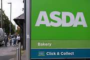 Asda supermarket chain sign in Kings Heath on 9th August 2021 in Birmingham, United Kingdom. Asda Stores Ltd. is a British supermarket retailer, headquartered in West Yorkshire. The company was founded in 1949 and was listed on the London Stock Exchange until 1999 when it was acquired by the American retail giant Walmart for £6.7 billion. Asda was the second-largest supermarket chain in Britain between 2003 and 2014 by market share, at which point it fell into third place. Since April 2019, it has regained its second-place position.