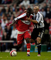 Photo: Jed Wee.<br /> Middlesbrough v Newcastle United. The Barclays Premiership. 22/10/2006.<br /> <br /> Middlesbrough's Yakubu (L) holds off Newcastle's Stephen Carr.