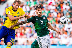 June 27, 2018 - Yekaterinburg, Russia - OLA TOIVONEN of Sweden and CARLOS SALCEDO of Mexico in action during the FIFA World Cup group stage match between Mexico and Sweden. (Credit Image: © Joel Marklund/Bildbyran via ZUMA Press)
