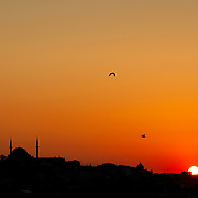 Istanbul skyline at sunset from the Bosphorus, with Suleymaniye Mosque