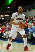 DALLAS, TX - JANUARY 4: Omar Calhoun #21 of the Connecticut Huskies brings the ball up court against the SMU Mustangs on January 4, 2014 at Moody Coliseum in Dallas, Texas.  (Photo by Cooper Neill) *** Local Caption *** Omar Calhoun