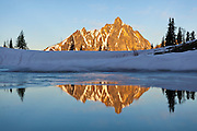 Mount Hardy at sunrise reflected in Upper Snowy Lake, Okanogan National Forest, Washington.
