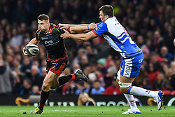 27th April 2019 , Principality Stadium , Cardiff, Wales ; Guinness pro 14's, Round 21, Dragons vs Scarlets ; Josh Lewis of Dragons evades the tackle of Dave Bullbring of Scarlets<br /> <br /> Credit :  Craig Thomas/Replay Images