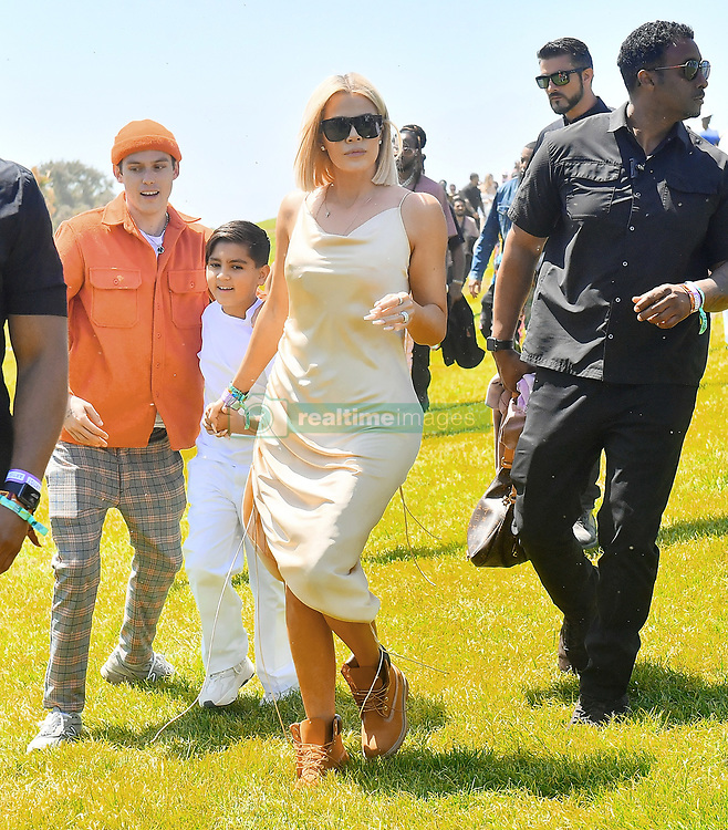 Kim & Khloe Kardashian were spotted leaving Kanye West's 'Church Sunday Services' at Coachella in Indio, CA, Kim was spotted holding daughter North West, and as well as her nieces and nephews as she ran upto the hilltop where her famous rapper husband was performing, Khloe was seen walking hand in hand with nephew Mason. 21 Apr 2019 Pictured: Kim & Khloe Kardashian were spotted leaving Kanye West's 'Church Sunday Services' at Coachella in Indio, CA, Kim was spotted holding daughter North West, and as well as her nieces and nephews as she ran upto the hilltop where her famous rapper husband was performing, Khloe was seen walking hand in hand with nephew Mason. Photo credit: Marksman / MEGA TheMegaAgency.com +1 888 505 6342