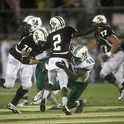 Central Florida quarterback Jeff Godfrey (2) gets tackled by  Marshall defensive lineman Ra'Shawde Myers (40) during an NCAA football game between the Marshall Thundering Herd and the Central Florida Knights at Bright House Networks Stadium on Saturday, October 8, 2011 in Orlando, Florida. (Photo/Alex Menendez)