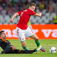 Netherlands' Robin van Persie (L) and Hungary's Roland Juhasz (R) fights for the ball during a World Cup 2014 qualifying soccer match Hungary playing against Netherlands in Budapest, Hungary on September 11, 2012. ATTILA VOLGYI