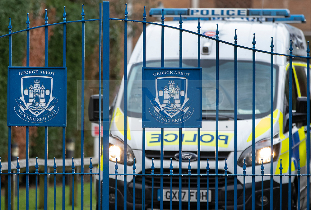 © Licensed to London News Pictures. 06/03/2019. Guildford, UK. A police van is seen at the gates of George Abbot Secondary School in Guilford, where a 15 year old pupil is reported to have stabbed another pupil in the back with a pair of scissors. Photo credit: Peter Macdiarmid/LNP