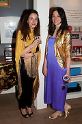 YOLANDA RENAZO; ALEXANDRA AL-BADER, Party hosted for Jason Wu by Plum Sykes and Christine Al-Bader. Ladbroke Grove. London. 22 March 2011. -DO NOT ARCHIVE-© Copyright Photograph by Dafydd Jones. 248 Clapham Rd. London SW9 0PZ. Tel 0207 820 0771. www.dafjones.com.