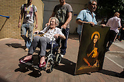Royalists portrait of Kate, Duchess of Cambridge and elderly patient outside St Mary's Hospital, Paddington London, where media and royalists await news of the  Duchess' impending birth to a baby boy. Some have been camping out for up to two weeks during a UK heatwave, having bagged the best locations where the heir to the British throne will eventually be shown to the waiting world.