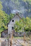 Farmhouse with a smoking chimney. Teth, Tethi, Albania. 03Sep15