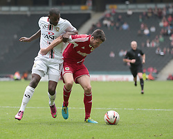 Bristol City's Brendan Moloney is challenged by Milton Keynes Dons' Izale McLeod  - Photo mandatory by-line: Nigel Pitts-Drake/JMP - Tel: Mobile: 07966 386802 24/08/2013 - SPORT - FOOTBALL - Stadium MK - Milton Keynes - Milton Keynes Dons V Bristol City - Sky Bet League One