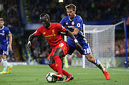 Sadio Mane of Liverpool in action with Cesar Azpilicueta of Chelsea marking. Premier league match, Chelsea v Liverpool at Stamford Bridge in London on Friday 16th September 2016.<br /> pic by John Patrick Fletcher, Andrew Orchard sports photography.