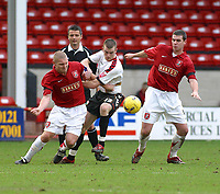Photo: Dave Linney.<br />Walsall v Barnet. Coca Cola League 2. 24/02/2007.<br />Barnet's  Barry Cogan (C) is outnumbered by Michael Dobsob(L) and Anthony Gerrard.