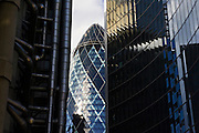 London landmarks Swiss Re Building between The Lloyds Building and The Willis Building, England, UK