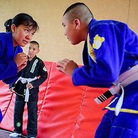 Amy Mitchell and her brother Myron Mitchell, right, prepare to practice Jiu Jitsu moves at their home in Tohatchi Tuesday.