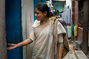 Nazma Akter out visting garment workers in Dhaka, Bangladesh. <br /> <br /> Nazma is the President of Awaj Foundation. The Foundation was founded by Zazma in 2003 to support and empower garment workers to negotiate safer and fairer working conditions.