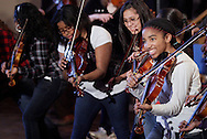 """Middletown music students rehearse with members of """"Barrage"""" at Twin Towers Middle School on Friday, Jan. 27, 2012. The 244 students were preparing to perform with """"Barrage"""" on Friday night."""
