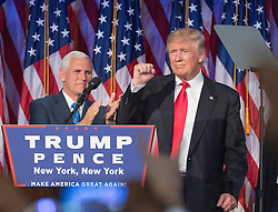 President-elect Donald Trump pumps his fist, with running mate Mike Pence standing by, following a speech to his supporters after winning the election at the Election Night Party at the Hilton Midtown Hotel in New York City, NY, USA, on Wednesday, November 9, 2016. Photo by J. Conrad Williams Jr./Newsday/TNS/ABACAPRESS.COM